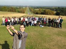 Dr Coskun Tuncer takes a 'selfie' with the students, at Cumberland Lodge